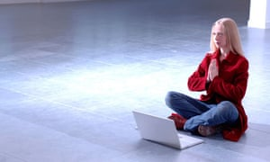 young woman sitting on floor with computer
