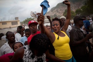 Haiti - A longer view: People sing and dance before a traditional wrestling match