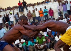 Haiti - A longer view: Jean Phillipe and Venes Pierre take part in a fight