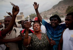 Haiti - A longer view: People pray to win bets on the winner