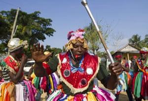 Haiti - A longer view: A woman participates in the ritual in the Dominican Republic