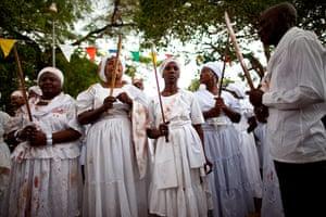 Haiti - A longer view: Haitians participate in a ritual during a Voodoo Festival
