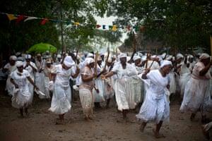Haiti - A longer view: Haitians take part in a Voodoo festival