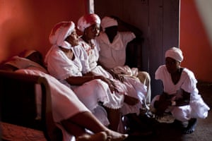 Haiti - A longer view: Voodoo believers gather after the ceremony in Haiti