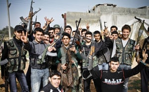 Aleppo, Syria: Young members of the Free Syrian Army show off their weapons, araquib city