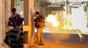 Aleppo, Syria: A rebel of the Free Syrian Army fires a rocket propelled-grenade