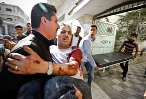 Aleppo, Syria: A man is carried in for medical treatment, Khan Sheyhoun