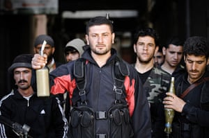 Aleppo, Syria: Rebels of the Free Syrian Army show off their Molotov cocktails