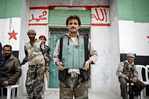 Aleppo, Syria: A rebel of the Free Syrian Army shows off his home-made body armour