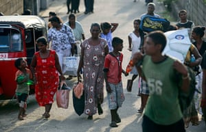 Indonesia earthquake: Sri Lankans leave their houses after a tsunami warning in Colombo
