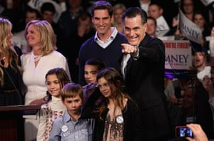 Pointing Mitt: Mitt Romney points to supporters during his primary night rally
