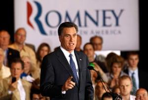Pointing Mitt: Mitt Romney speaks at his Illinois primary night rally in Schaumburg