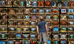 man browsing art
