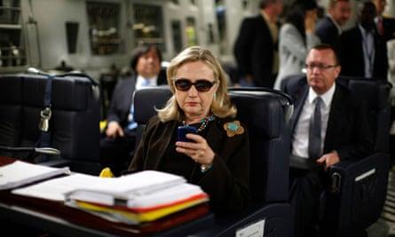 U.S. Secretary of State Hillary Clinton checks her PDA