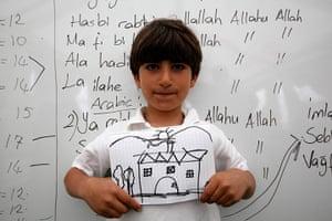Boynuyogun refugee camp: Children show drawings of their dream home at Boynuyogun refugee camp