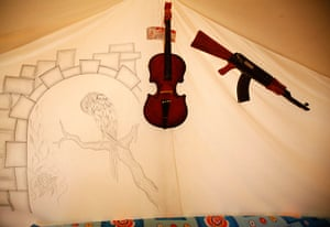 Boynuyogun refugee camp: Drawing, toy gun and violin are seen on tent canvas at Boynuyogun camp