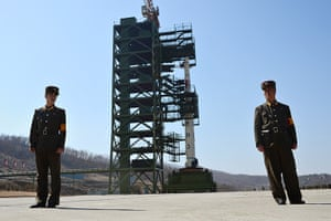From the agencies: Two North Korean soldiers stand guard in front of the Unha-3 rocket