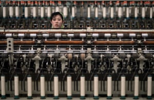 From the agencies: A woman works in a textile factory in Pyongyang
