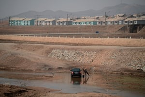 From the agencies: A North Korean man washing his car along the railway line