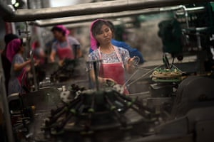 From the agencies: North Korean employees work in a textile factory in Pyongyang