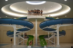 From the agencies: North Korean students ride down a water slide