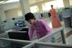 From the agencies: A North Korean woman checks a computer a at music software company