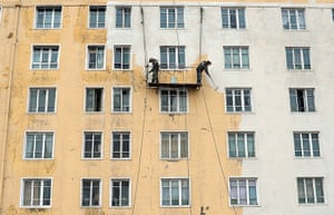 From the agencies: North Korean workers paint a building in Pyongyang