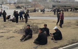From the agencies: North Korean workers take a break in a street  of Pyongyang