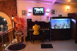 From the agencies: A woman plays the piano in a restaurant in Pyongyang