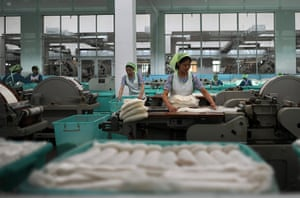 From the agencies: North Korean women work in a textile factory in Pyongyang