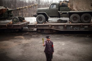 From the agencies: A North Korean controller along a railway line