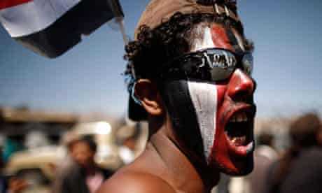 An anti-government protester shouts slogans during a march in Sanaa