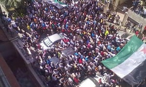 Syrian anti-government protesters demonstrate after Friday prayers in Homs