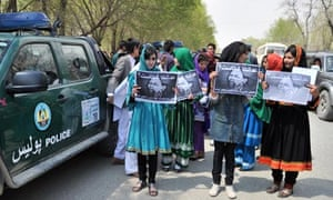 Afghan Young Women for Change hold placards saying 'Where is justice?'