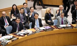 China's UN ambassador Li Baodong votes during a security council meeting on Syria