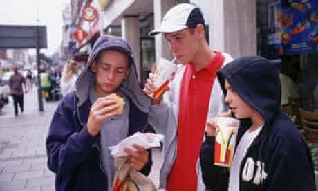 Adolescents eating junk food