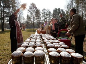 Orthodox Easter: An Orthodox priest blesses Easter cakes during an Easter service in Belarus