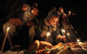 Orthodox Easter: Orthodox believers light candles during a mass in Bishkek, Kyrgyzstan