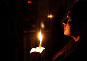 Orthodox Easter: A Christian Orthodox believer holds her candle in Anthoupoli, Cyprus