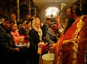 Orthodox Easter: A priest blesses worshipers at Kievo-Pecherskaya Lavra cathedral in Kiev