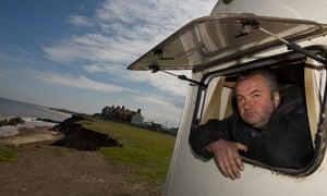 Nigel Cutting in his caravan in Happisburgh, Norfolk