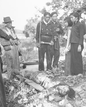 Colonial papers: Police standing over bodies of slain Communist in Malaya