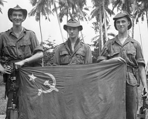 Colonial papers: Three British Soldiers Holding Communist Flag