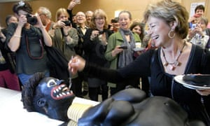 Swedish culture minister Lena Adelsohn Liljeroth feeds cake to blacked-up artist Makode Aj Linde