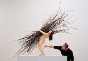 Ron Mueck exhibition: Finshing touches to 'Woman with sticks' 2008 (Mixed Media) by Ron Mueck