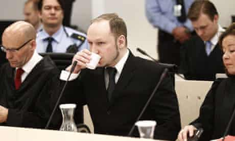 Anders Behring Breivik flanked by defence lawyers at his trial in Oslo