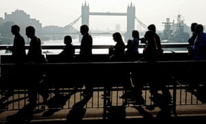 Workers head for the capital's financial centre in the City