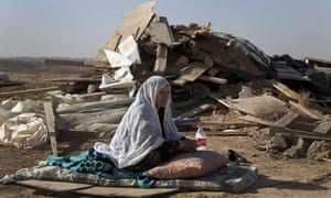 A bedouin woman from al-Turi family sits