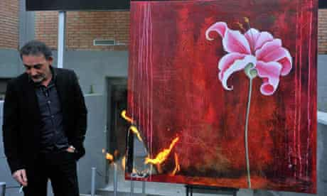 Antonio Manfredi, director of CAM of Casoria, burns a painting of French artist Severine Bourguignon