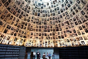Holocaust memorial: Visitors look at pictures of Jews killed in the Holocaust